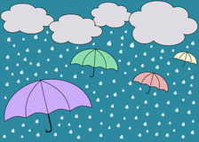 Rainy blue sky with colorful umbrellas. And clouds Royalty Free Stock Photo