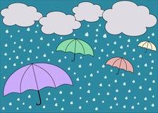 Rainy blue sky with colorful umbrellas Royalty Free Stock Photo