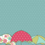 Rainy Card. Rectangular card with three umbrellas Royalty Free Stock Photos