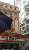 Rainy Chicago Day. Chicago theater and umbrella Royalty Free Stock Photos