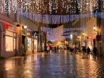 Free Rainy Christmas   In The City Tallinn Old Town Street Night  Light People Walking With Umbrellas Rain Drops Reflection On Window S Stock Photos - 165341163