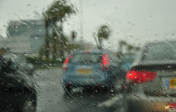 Rainy city. Abstract view (through the car window) of the city under rain royalty free stock images