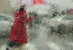 Rainy city. Abstract view (through the car window) of the city under rain royalty free stock image