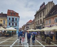 Rainy city break in Brasov, Romania stock photography