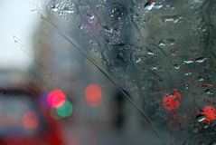 Rainy city scenery through wet windscreen Stock Photo