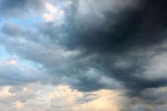 Rainy cloud at sunset Royalty Free Stock Images