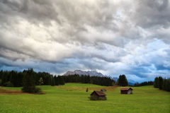 Rainy clouded sky over alpine meadows Stock Photos