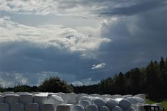 Rainy clouds. Dramatic rain clouds over straw bales Stock Photography