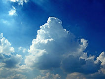 Rainy clouds in sunny blue sky Royalty Free Stock Photo