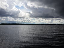 Rainy clouds and wind above the lake Royalty Free Stock Image