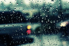 Rainy commute. Traffic scene with water on window royalty free stock photos