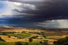 Rainy dai in Tuscany. Rain clouds over the hills of Toscana, Italy Stock Image