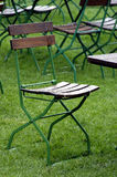 Rainy Day. Abandoned chair in a garden after a heavy rainstorm Royalty Free Stock Photo