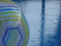 Rainy Day. At the swimming pool with beach ball and volleyball net Royalty Free Stock Photography