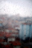 Rainy day. Elevated view of houses and rain droplets Stock Images