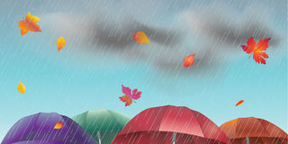 Rainy day. Autumn, rainy sky landscape with fall leaves, umbrella, rain, sky with clouds. Autumn Rainy sky,rain weather, fall season, rain drops background Royalty Free Stock Photography
