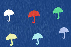 Rainy day background. Colorful umbrellas and rain for a background Stock Image