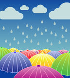 Rainy Day. Background with open colourful umbrellas and rainy weather Royalty Free Stock Photos