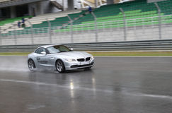 Rainy day BMW test drive. Anonymous BMW owners join the BMW car test drive event in Sepang International Circuit at a rainy day in May, 2010 Stock Photos