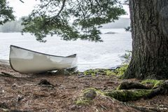 Rainy day in Canada Ontario Lake of two rivers white blank Canoe Canoes parked on island in Algonquin National Park. Rainy day in Canada Ontario Lake two rivers stock photography