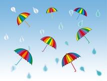 Rainy day. Colorful umbrellas and rain drops royalty free illustration
