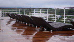 Rainy Day on a Cruise Ship Abandoned Deck Chairs Stock Photos