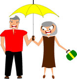 Rainy day. Happy mature couple being together under an umbrella on a rainy day - isolated on white background Royalty Free Stock Photography