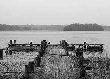 Rainy day at the lake on a small jetty Stock Photos