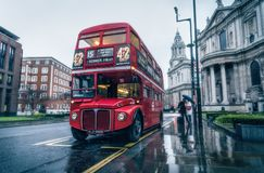 Rainy day in London, double-decker next to St. Paul`s Cathedral Royalty Free Stock Images