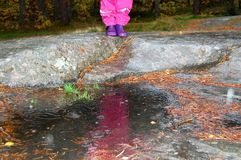 A rainy day. Rainy day with my grandson,reflections in a puddle Stock Photography