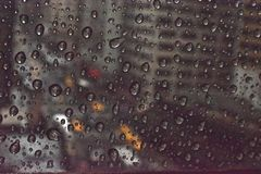 Rainy Day New York. Focused on the rainy window looking down on New York streets Royalty Free Stock Image