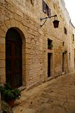 Rainy day on the old narrow street in  Mdina - Silent City Stock Photos