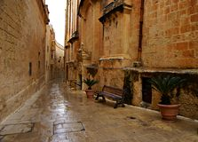 Rainy day on the old narrow street in  Mdina - Silent City Royalty Free Stock Image
