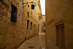 Rainy day on the old narrow street in  Mdina - Silent City Royalty Free Stock Photos