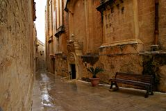 Rainy day on the old narrow street in  Mdina - Silent City Royalty Free Stock Images