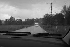 A rainy day outside a car window. In blacka and white Royalty Free Stock Photo