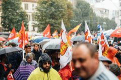 Rainy day over political march during a French Nationwide day ag. STRASBOURG, FRANCE - SEPT 12, 2017: Heavy rain over people at political march during a French Royalty Free Stock Image