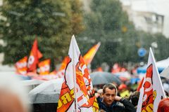 Rainy day over political march during a French Nationwide day ag. STRASBOURG, FRANCE - SEPT 12, 2017: Heavy rain over people at political march during a French Stock Photos