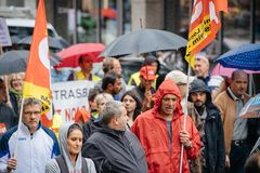 Rainy day over political march during a French Nationwide day ag. STRASBOURG, FRANCE - SEPT 12, 2017: Heavy rain over people at political march during a French Royalty Free Stock Photos