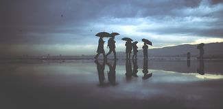 Silhouettes of rainy day royalty free stock photography