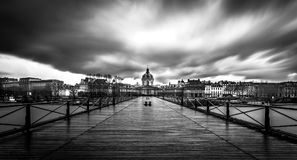 Rainy Day at The Pont Des Arts. This is a long exposure of a shot taken during a cold and rainy day in Paris during winter Stock Image