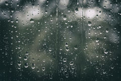 Rainy Day. Rain drops falling on a window Stock Photo