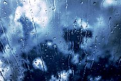 Rainy Day. Rain trickling down the glass surface Royalty Free Stock Photo