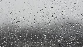 Rainy day, raindrops dripping on the window glass.  stock footage