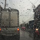 Rainy day on Road. Rainy on Car Windshield on the road in Thailand Royalty Free Stock Image