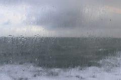 Rainy window. Rainy day at sea with grey sky royalty free stock photo