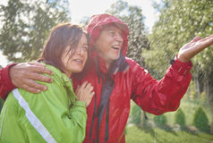 Rainy day. Senior couple embracing in rain Stock Photo