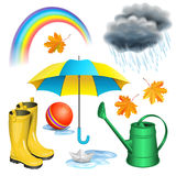 Rainy day set. Umbrella, boots, rainbow, clouds with raindrops. Paper boat in puddle, green watering can, children red ball, maple leaves. Autumn rain Royalty Free Stock Photo