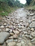 Rainy day in Spanish mountains. Wet stones. Hard path Stock Photo