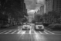 Rainy day street scene at Park Avenue New York City, Black and W Stock Image